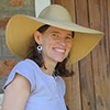 Nancy Smith-Mathers wearing a straw hat