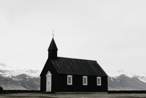 Church painted black in a stark landscape in Iceland