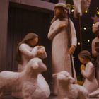 nativity set with baby Jesus, Mary, Joseph, a wise man, and sheep