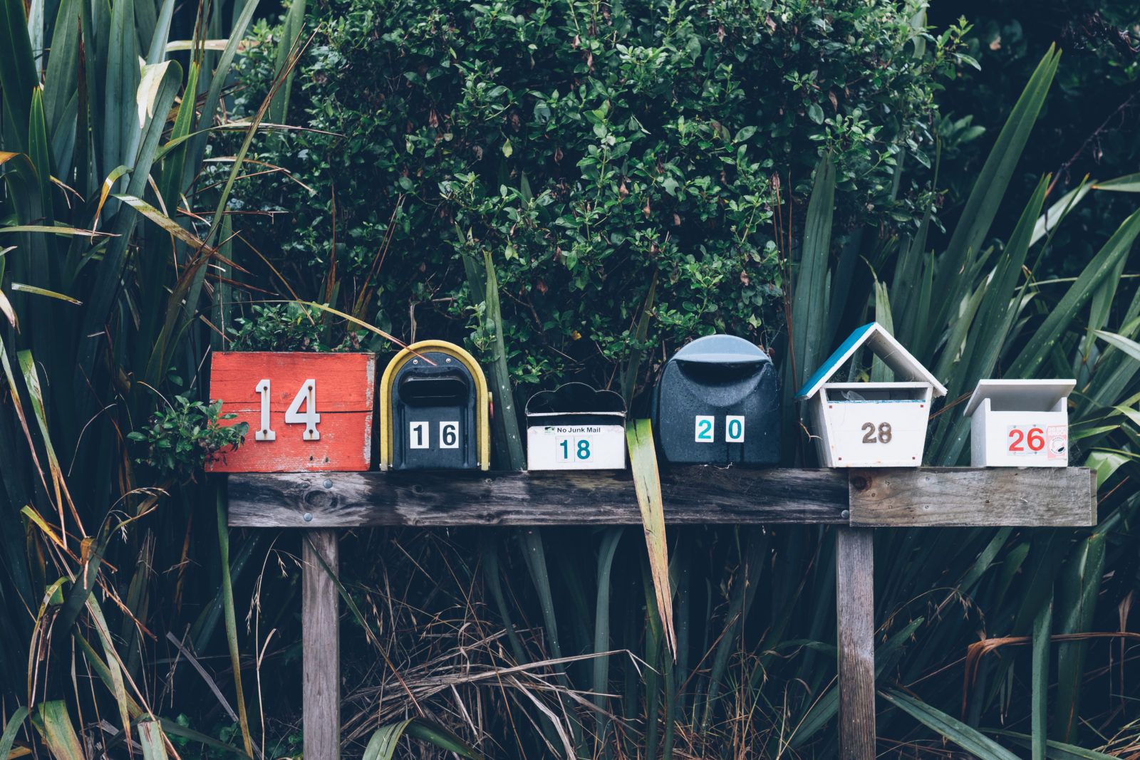 A row of colorful and quirky mailboxes