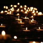 A number of candles lighting up the darkness