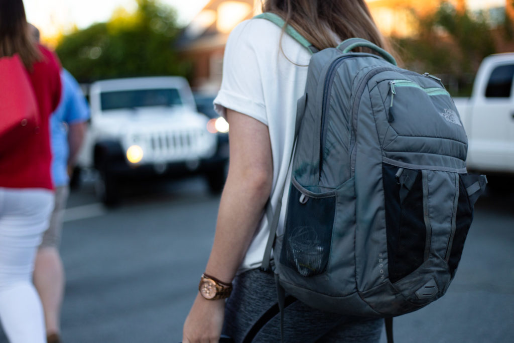 girl with a backpack turned away from the camera
