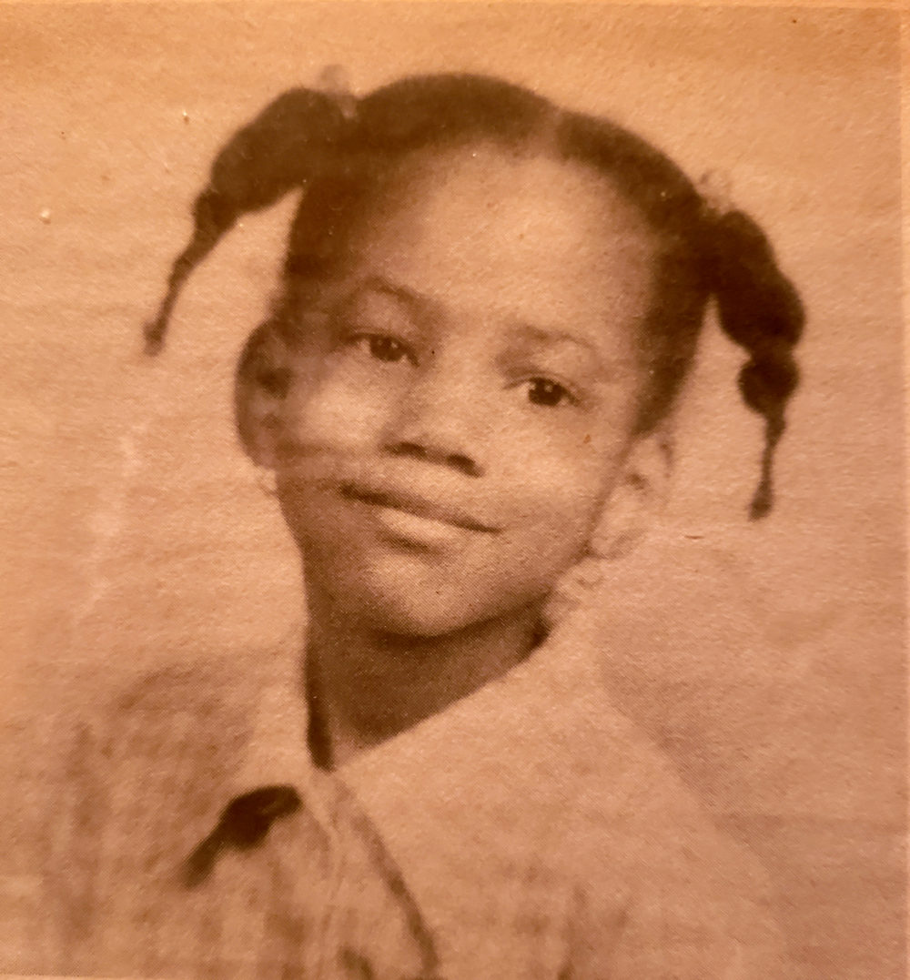 Aged photo of Denise as a young girl
