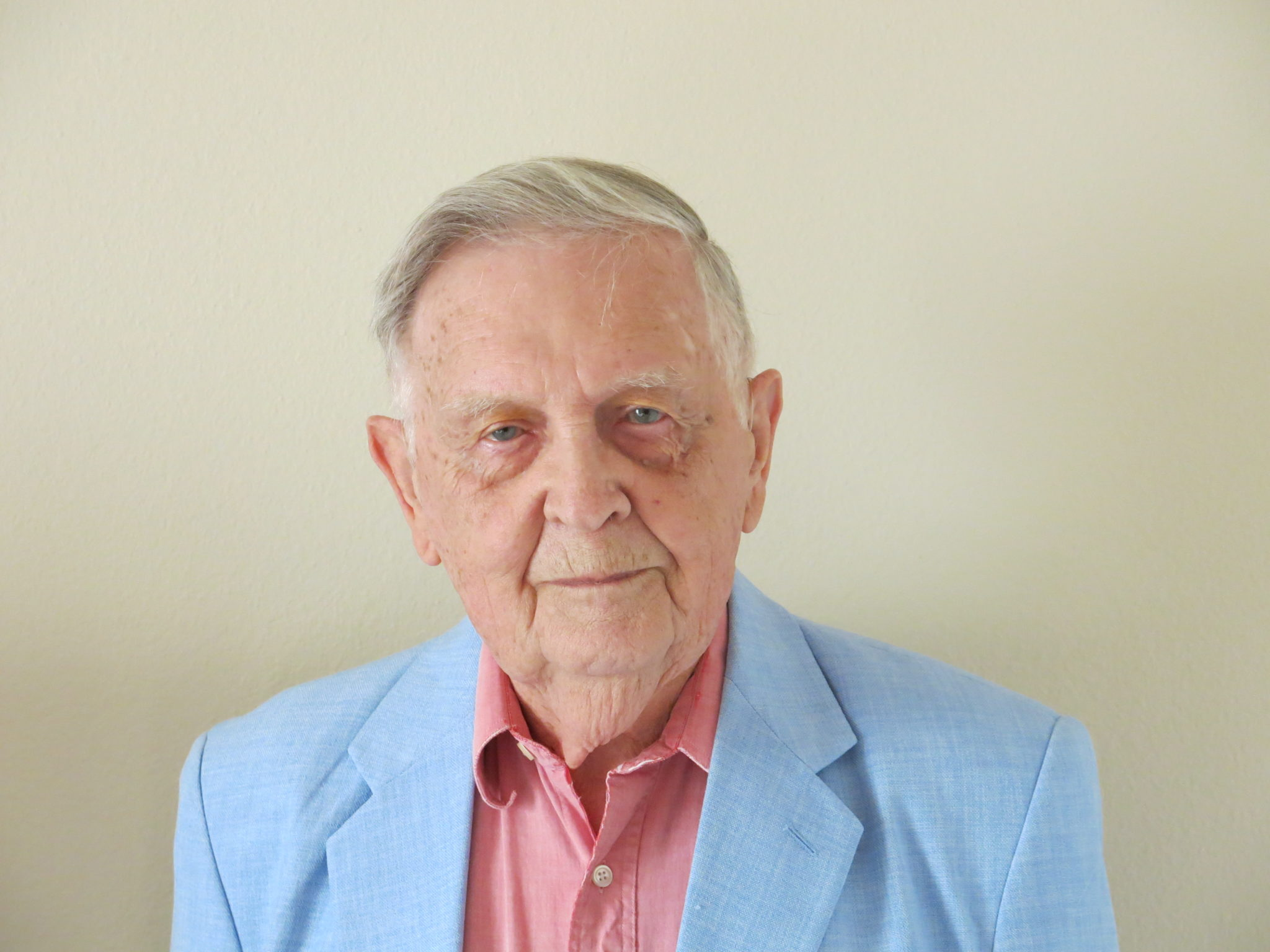 Elderly Caucasian man in light blue sport coat