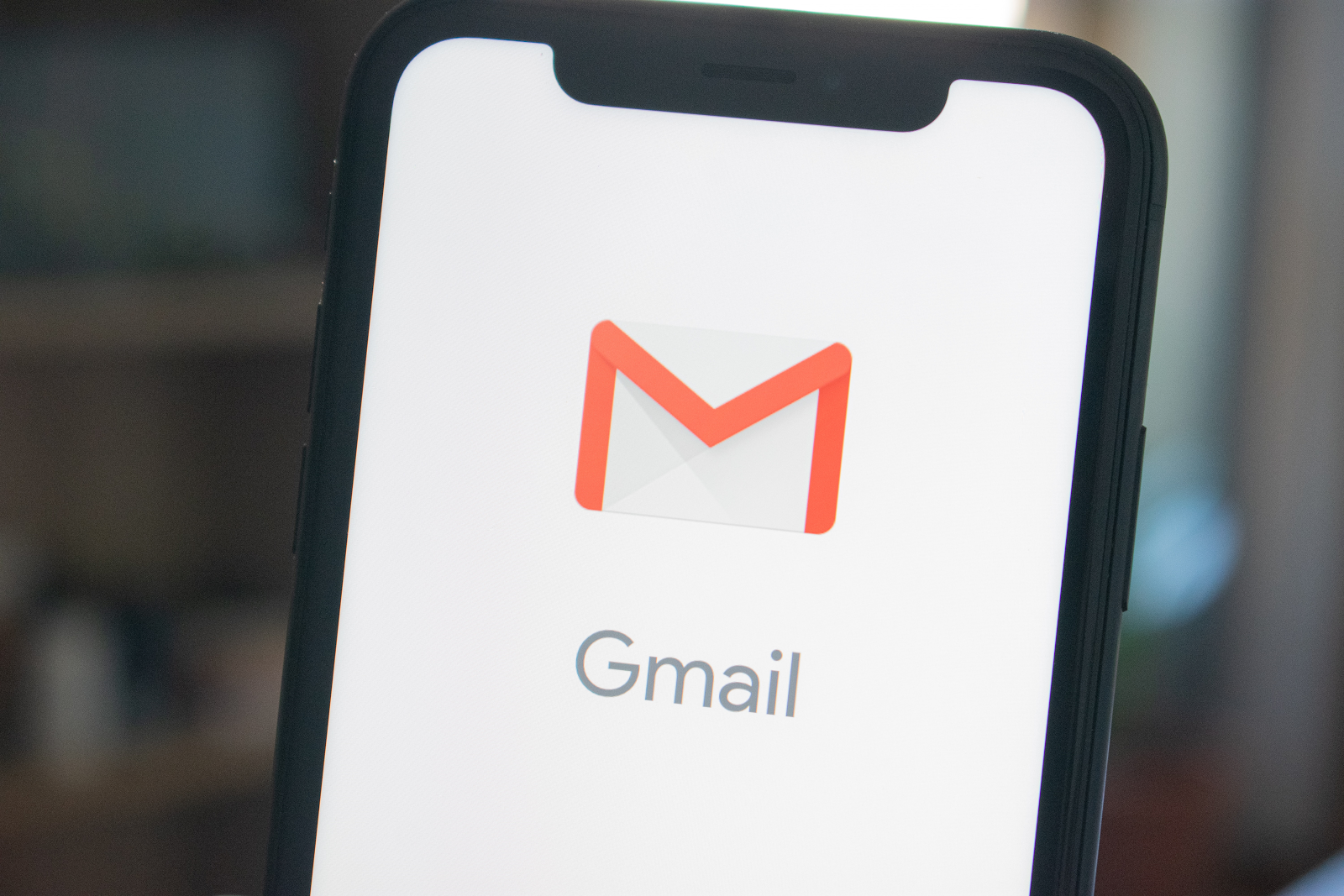 Smart phone with Gmail icon and word