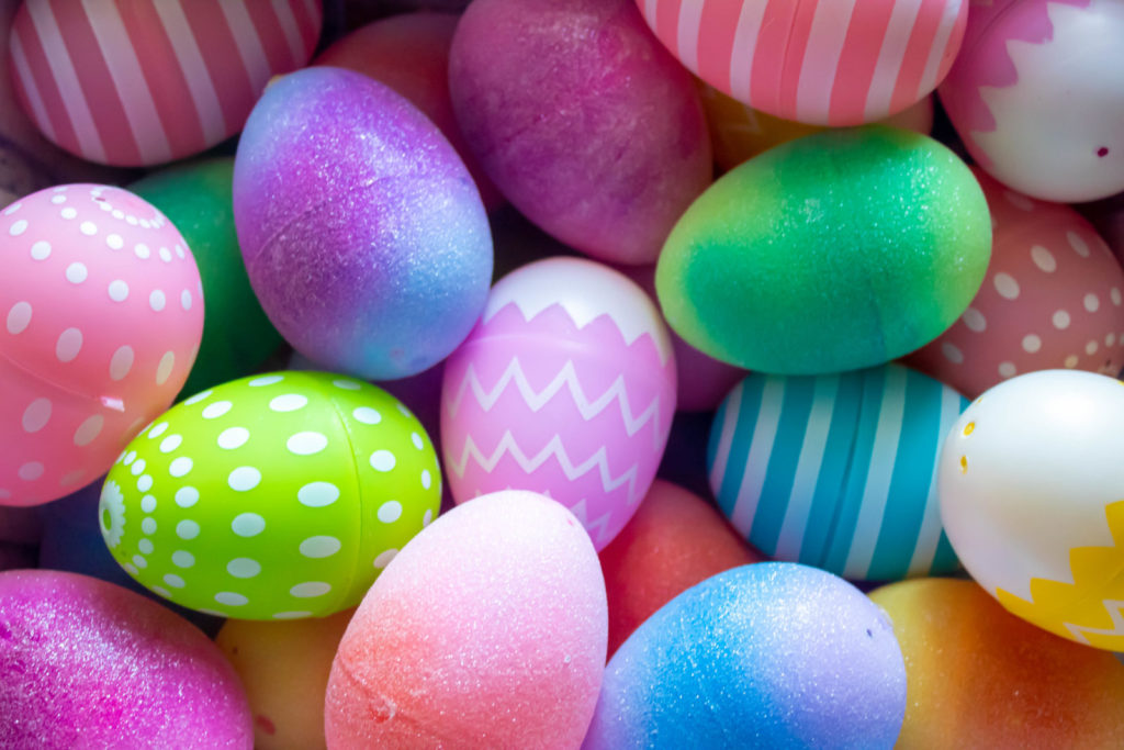 A mass of bright and colorful dyed eggs
