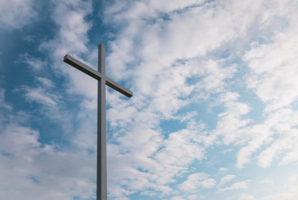 Image of a cross against the backdrop of the sky to represent that Lent prepares us to remember the resurrection