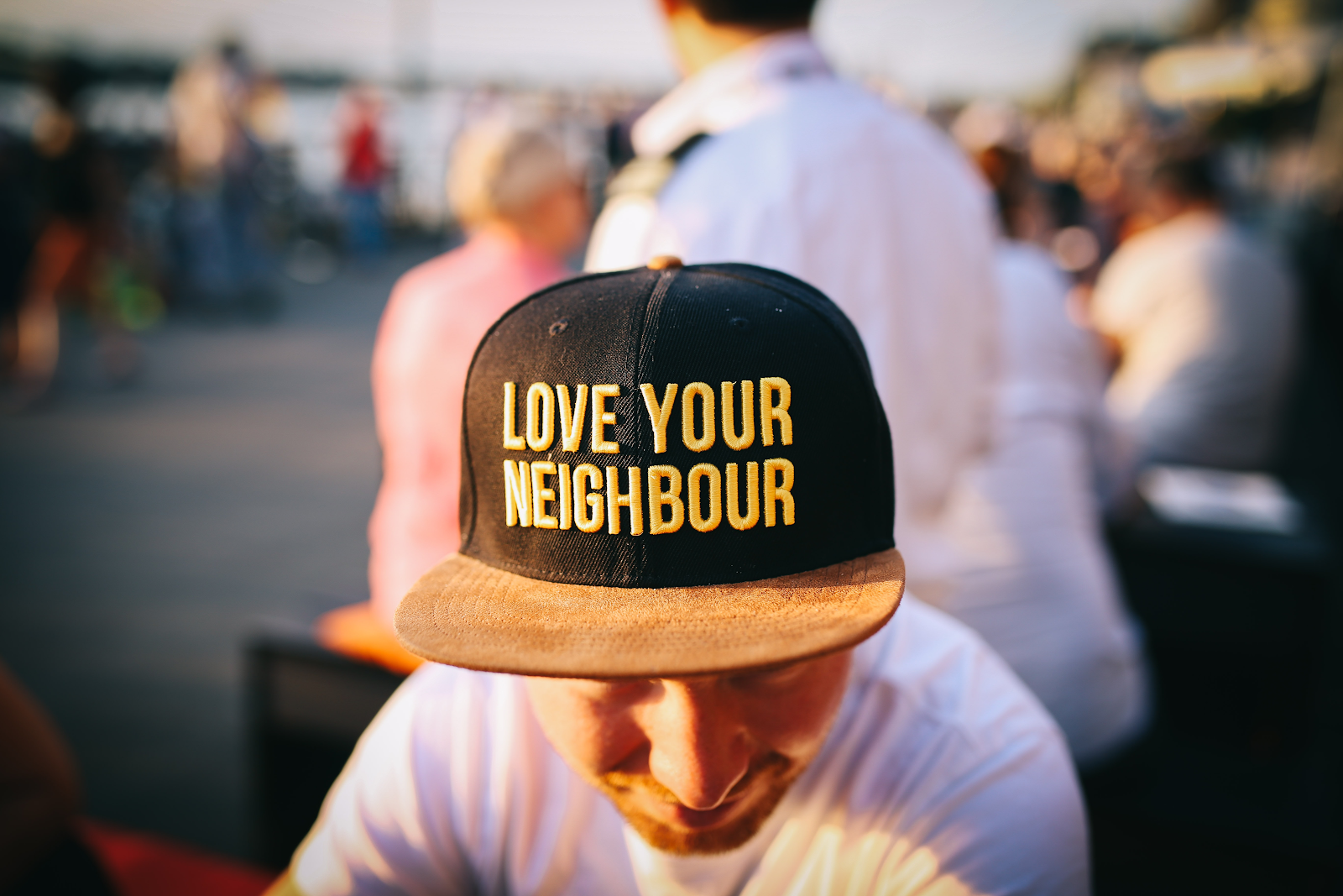 Man wearing baseball cap that says Love Your Neighbor