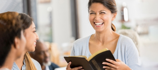 A group of women studying the Bible, one way to discern whether you want to become a Christian