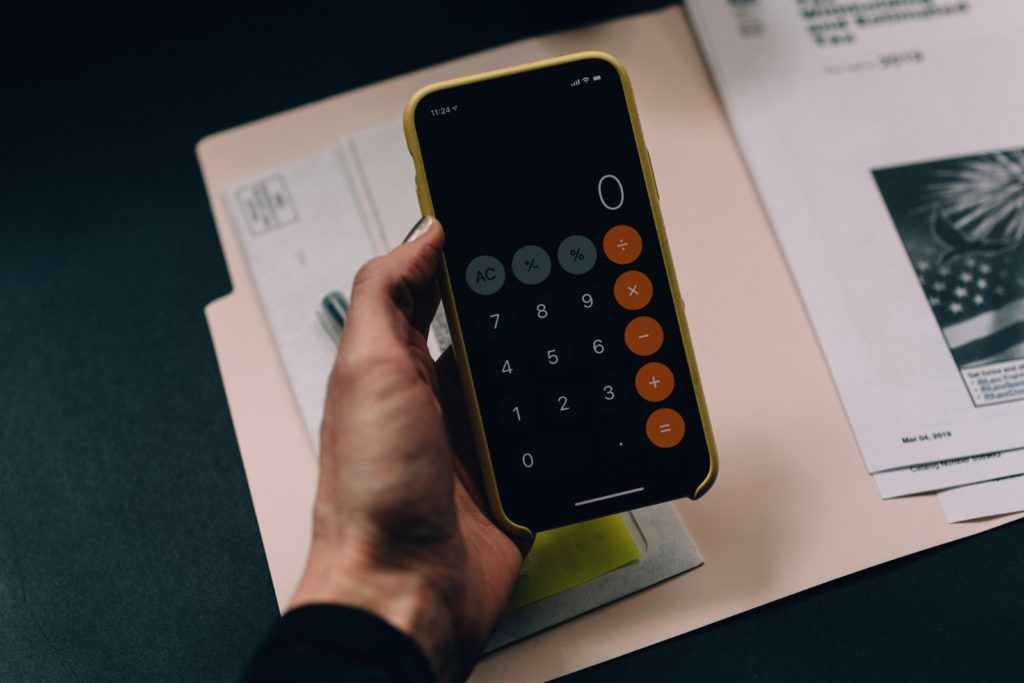 black Android smartphone being used as a calculator