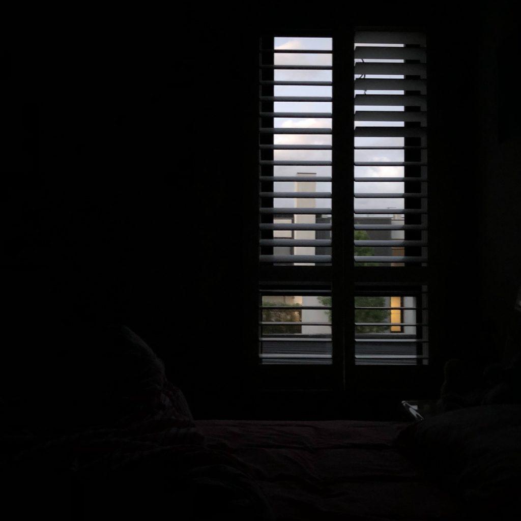 Dark room with small window