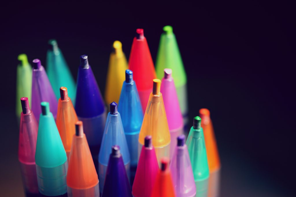 multi colored pen lot on black background