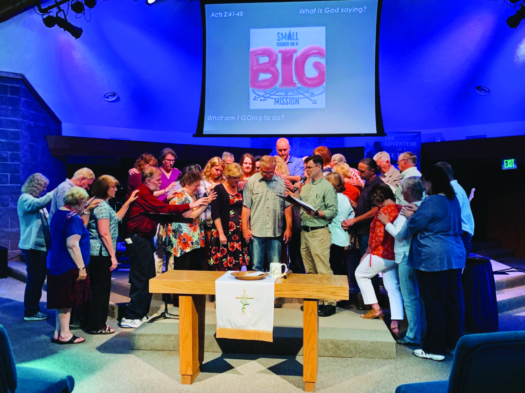 Church leaders lay hands on their pastor and pray over him before his sabbatical.