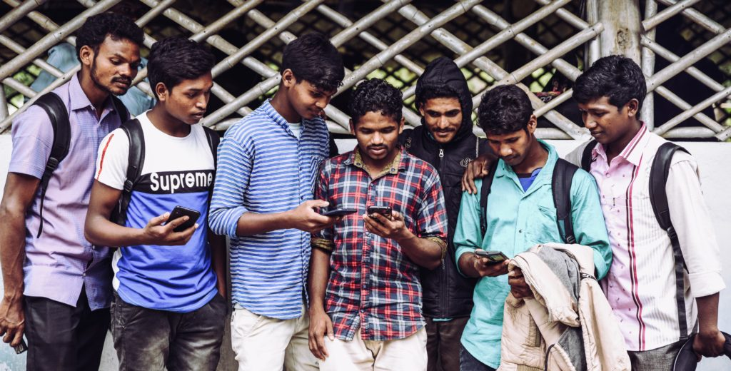 Cluster of Indian men explore new audio Bible app