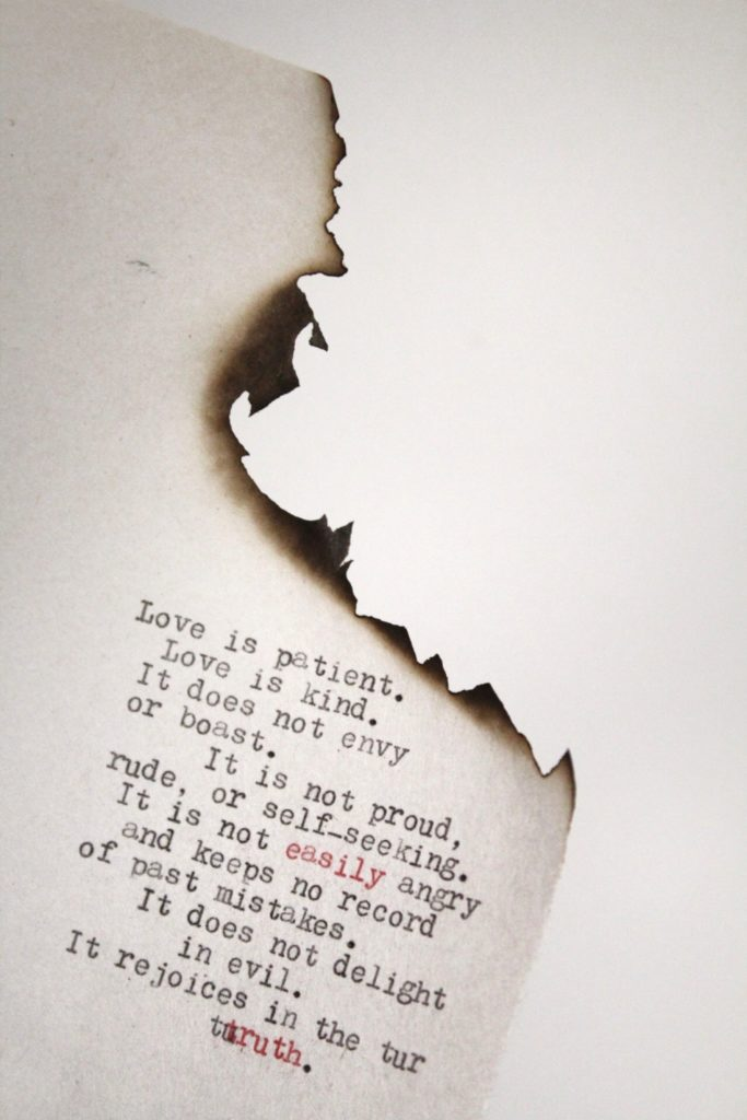 1 Corinthians 13 typed on burned paper