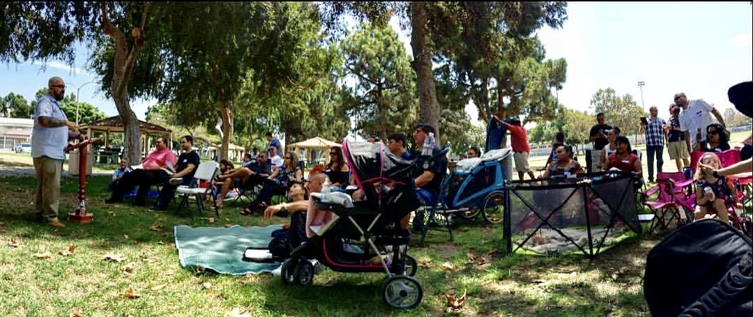 Early worship services for Reformed Church of Los Angeles took place in a local park, where people sit on blankets and lawn chairs while listening to the pastor.