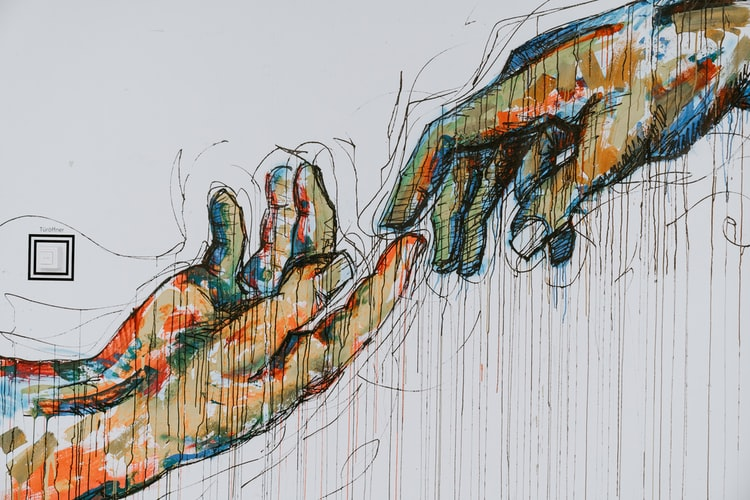 "A colorful sketch of two hands touching at finger point, reminiscent of Michelangelo's ""Creation of Adam."""