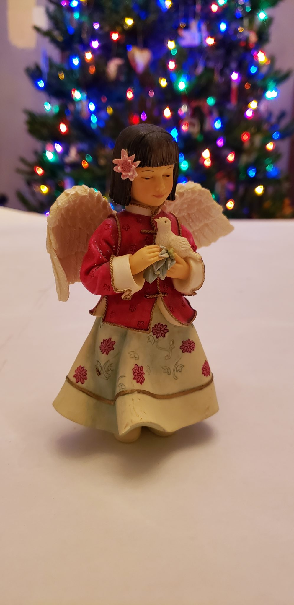An angel in Japanese-style dress is part of a Christmas nativity.