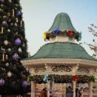 A French gazebo and Christmas tree decorated for the holidays.