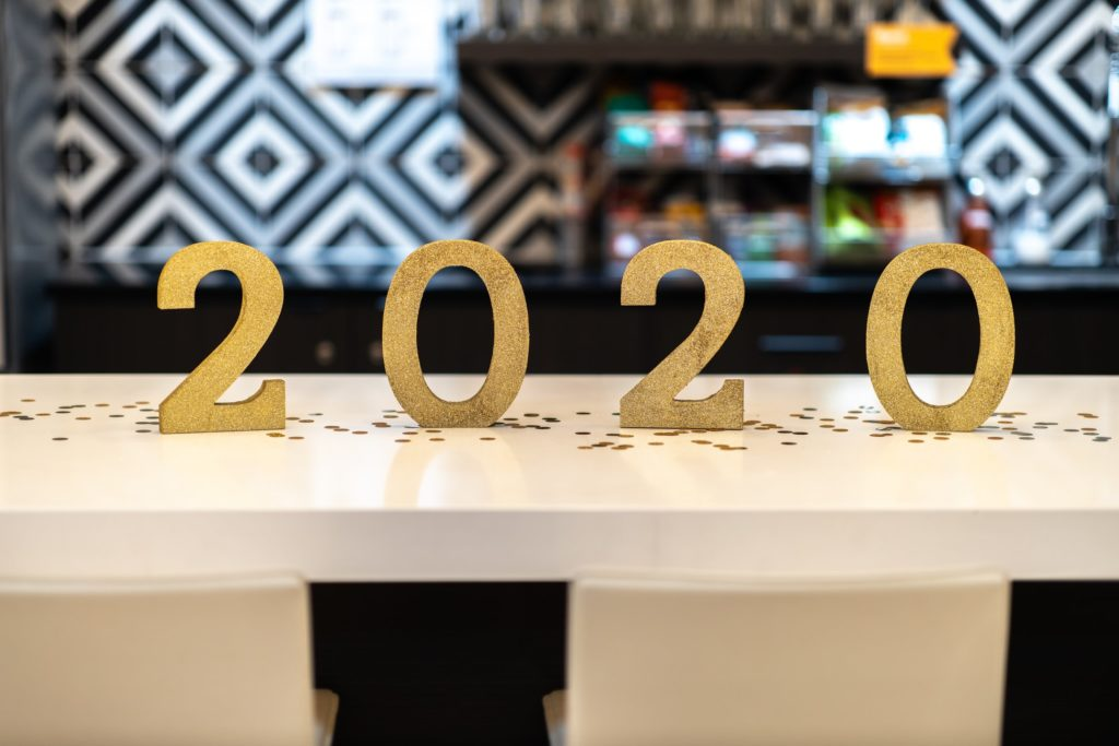 Golden 2020 numbers sit on a white countertop