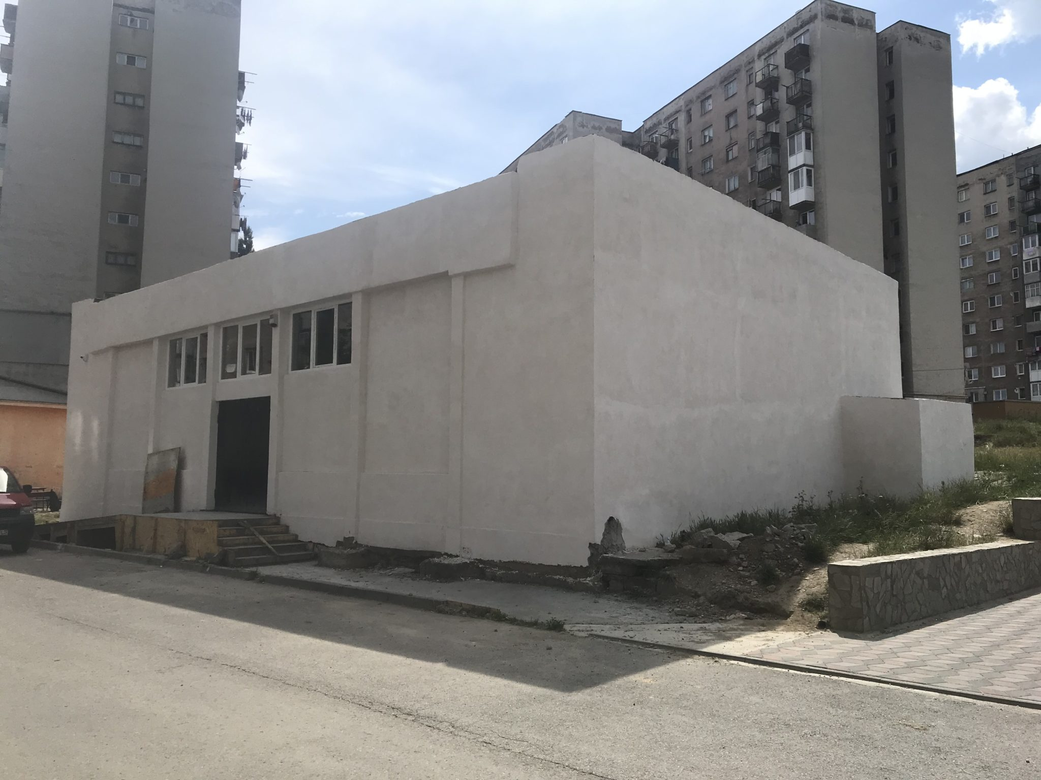 A cement building amid high-rise apartments is the site of a new church plant in Romania.