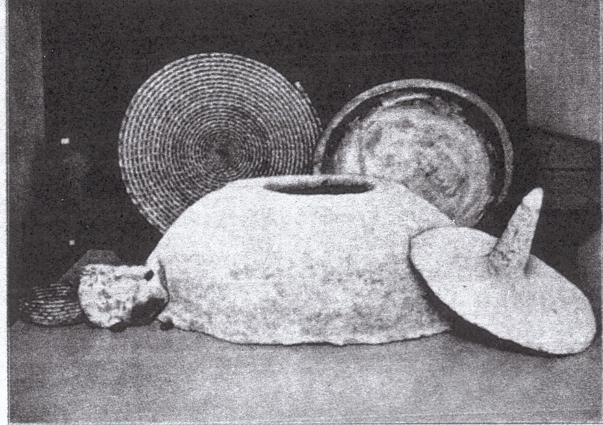 Tabun oven set against backdrop showing a straw-woven plate and dough-kneading bowl (from the Museum of the Palestine Institute, Jerusalem)
