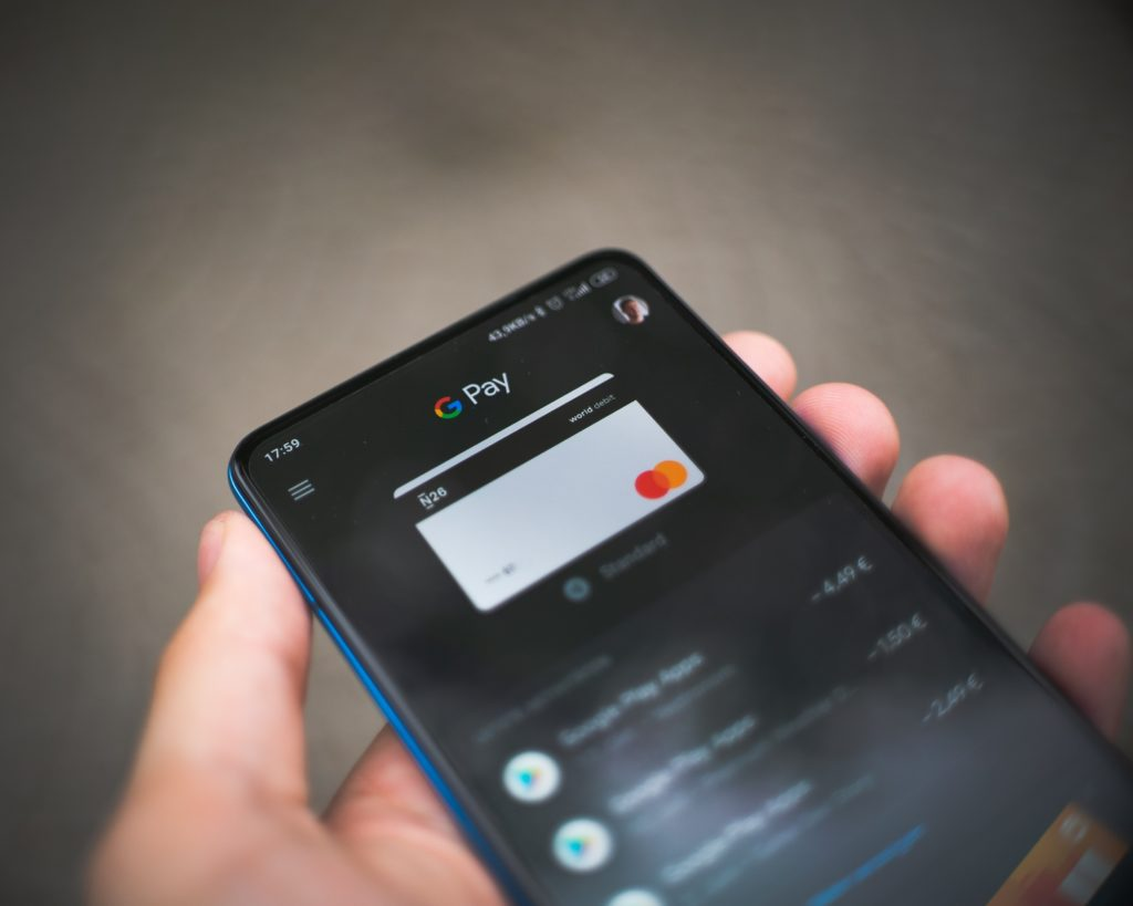 smartphone being used to make an online payment
