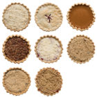 Looking down at eight different types of pies