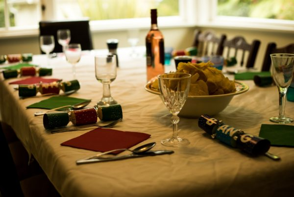 table with glass cups and place mats